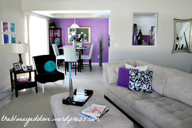 A living room painted in two colors: Purple and gray