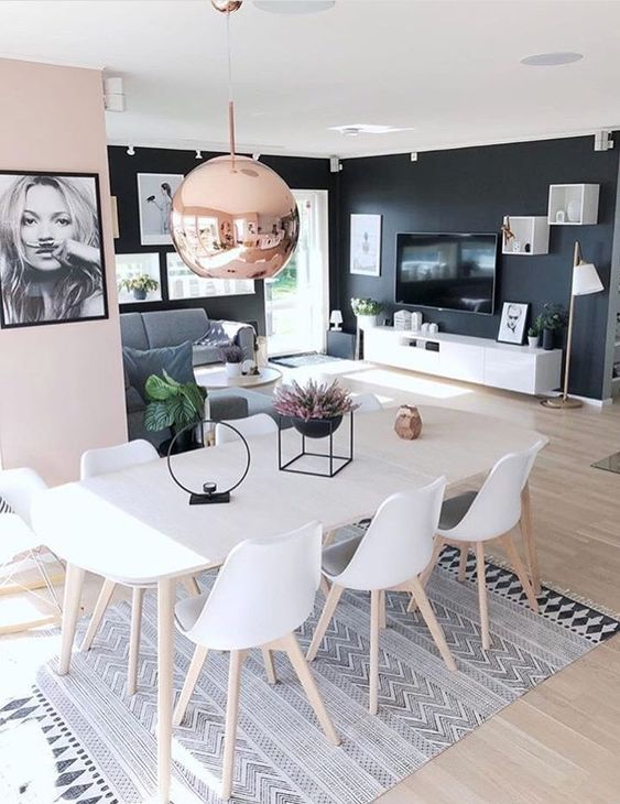 A living room painted in two colors: pale pink and black