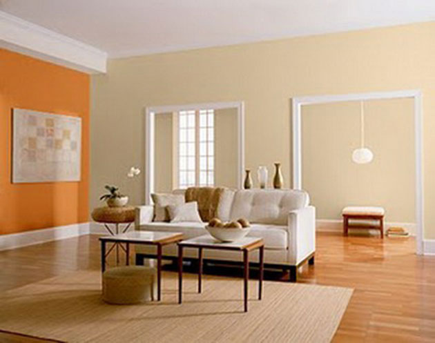 A living room painted in two colors: orange and beige