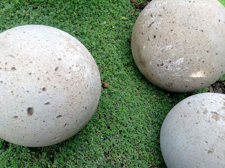 11. Decorate your garden with pretty concrete globes
