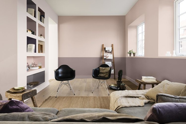 A living room painted in two colors pink and greyish purple
