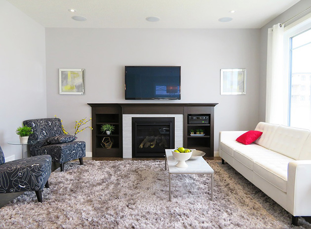 A living room painted in two colors: Gray and white