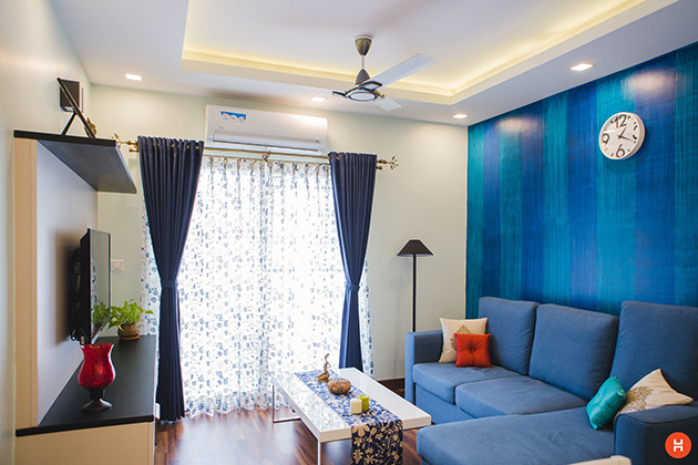 A living room painted in two colors: blue and white