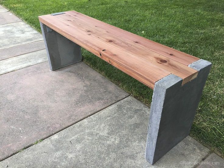 21. Make a garden bench with wood and concrete