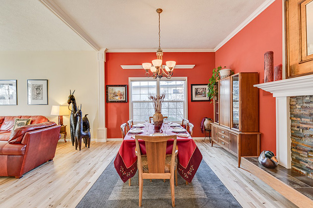 A living room painted in two colors: red and beige