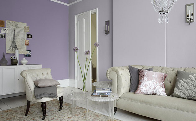 A living room painted in two colors: pale green and white