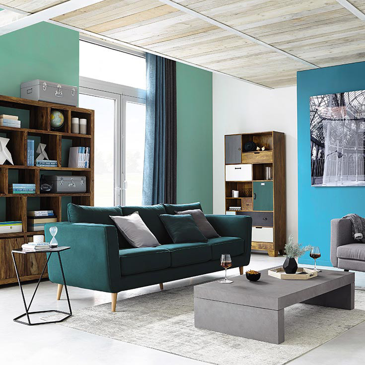 A living room painted in two colors: Blue and green
