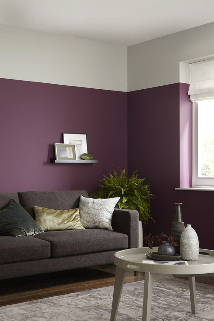 A living room painted in two colors: purple and white