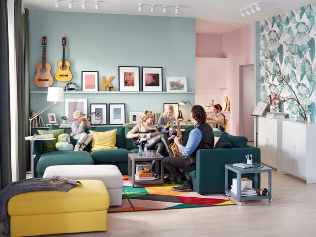 A living room painted in two colors: pink and greenish blue