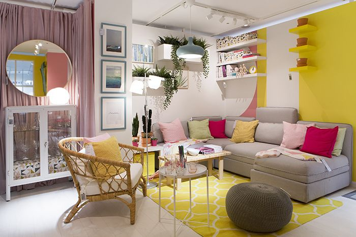 A living room painted in two colors: Pink and yellow