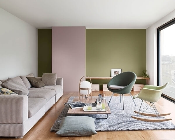 A living room painted in green and mauve