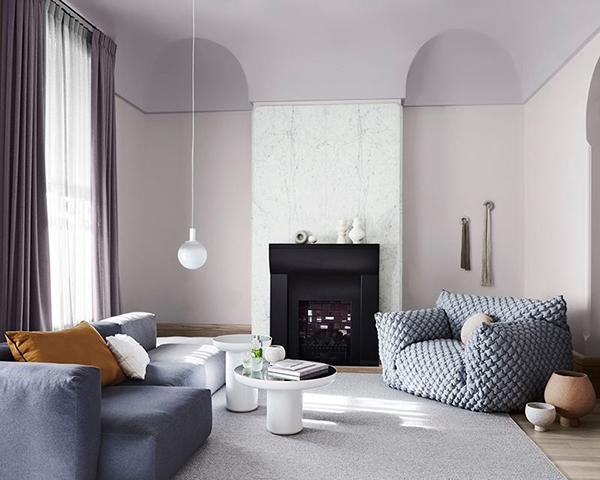 A living room painted in two colors: Mauve and off-white