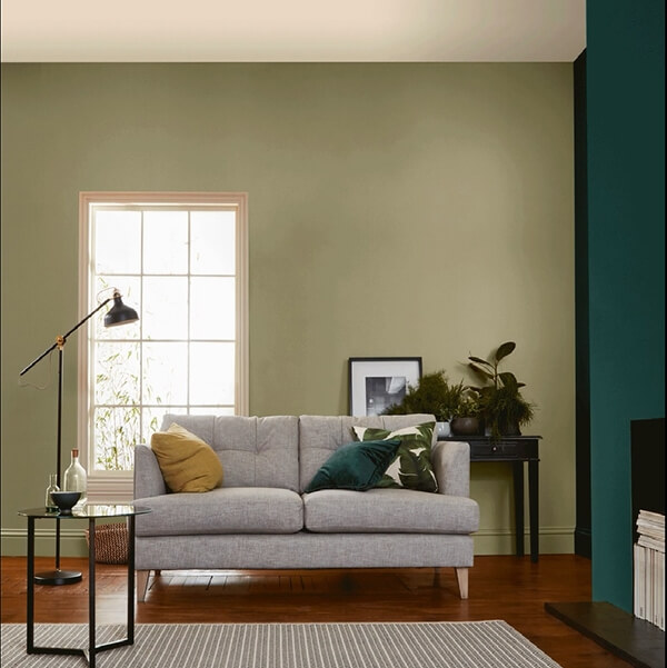 A living room painted in two shades of green