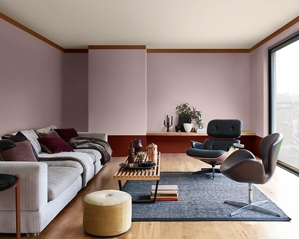 A living room painted in two colors: Mauve and burgundy red