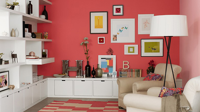 A living room painted in two colors: Coral and pink