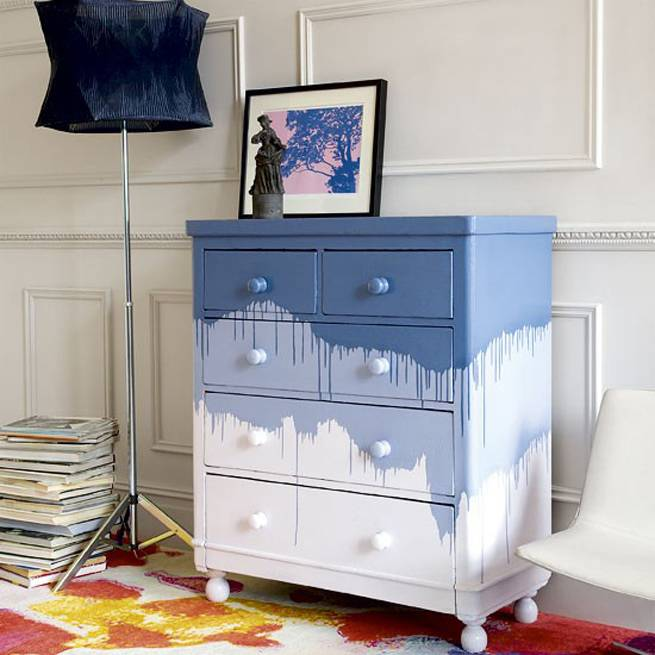 chest of drawers with three colors and splashes of paint
