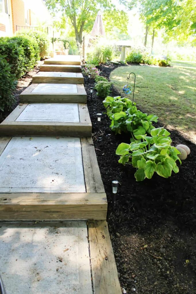 Wooden and concrete steps for a garden path.