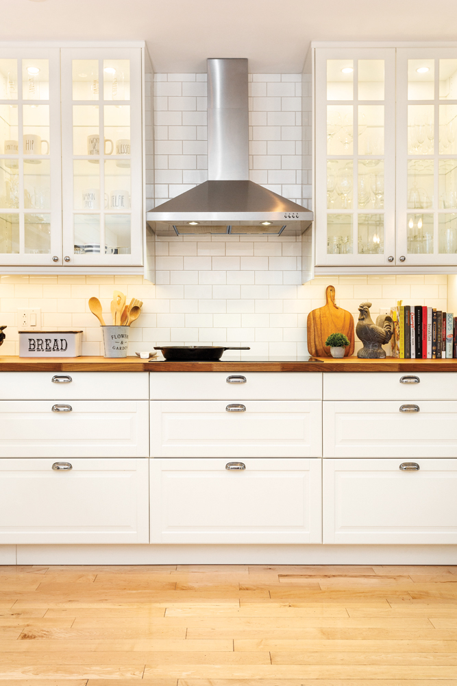 kitchen cabinet transformation with glass panels