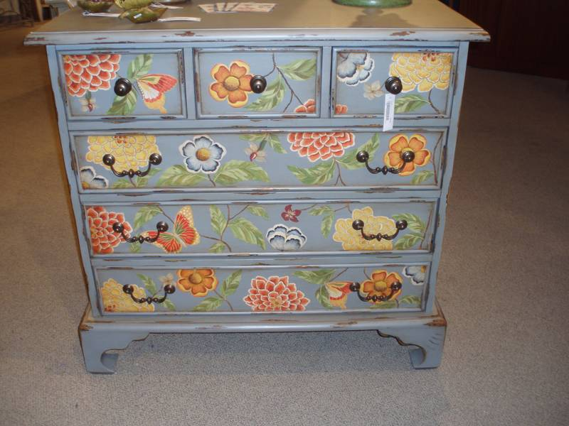 chest of drawers with painted flowers
