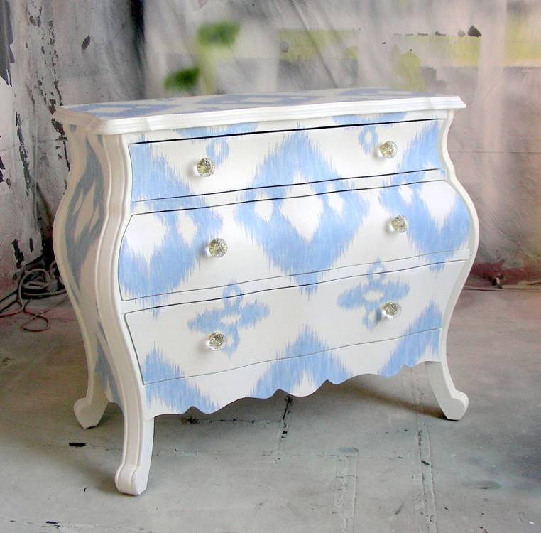 chest of drawers with faded geometric patterns